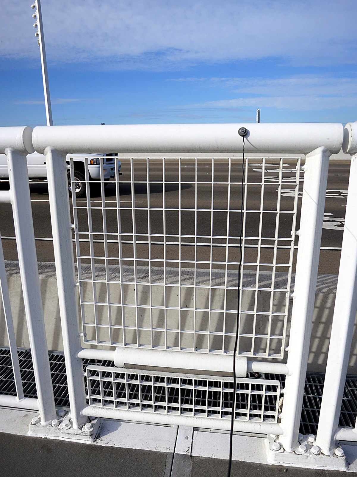 Bay Bridge Assay 1: the new safety railings are in sections.