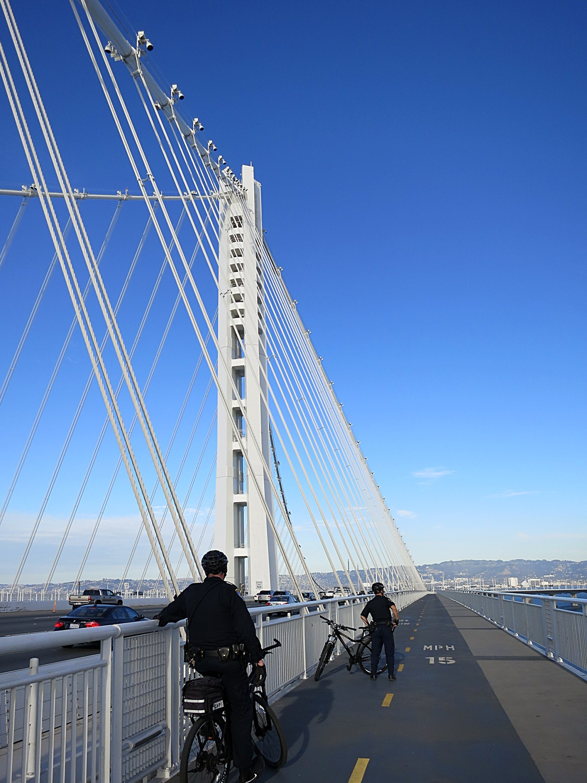 Bay Bridge Assay 1: a police team patrols the new Bay Bridge pedestrian walkway.