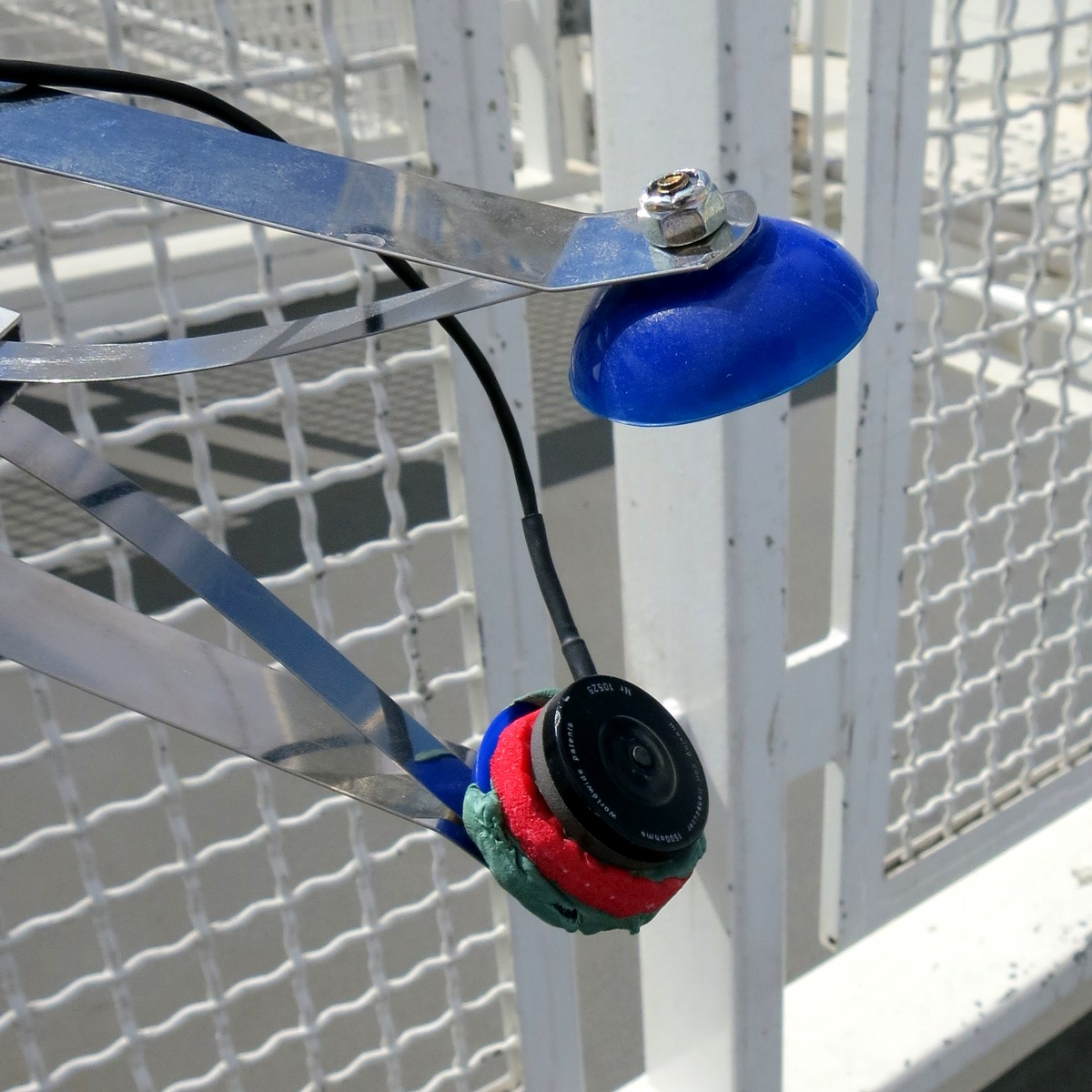 The extended reach mechanism shows signs of its adjustment after the walk.